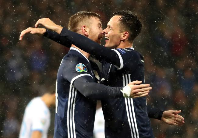 Scotland's Stuart Findlay (left) celebrates scoring his sides fifth goal with teammate Lawrence Shankland during the UEFA Euro 2020 qualifying match at Hampden Park, Glasgow. PA Photo. Picture date: Sunday October 13, 2019. See PA story SOCCER Scotlan