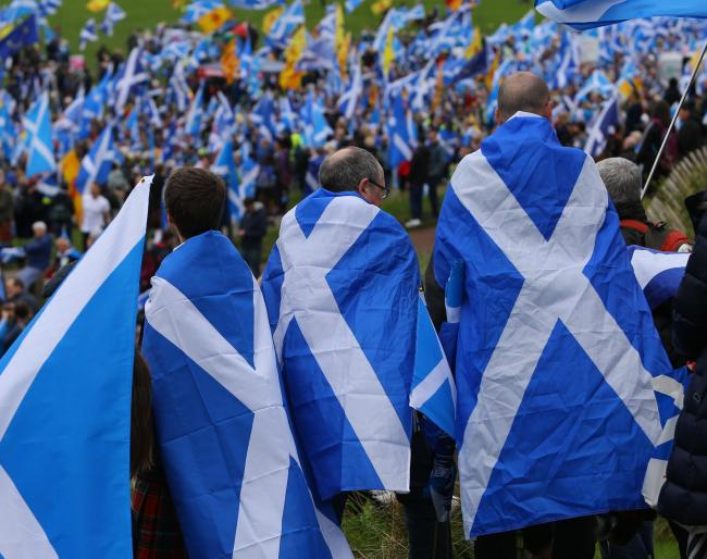All Under One Banner march for independence, Edinburgh. Marchers in Holyrood park before the march...  Photograph by Colin Mearns.5 October 2019..