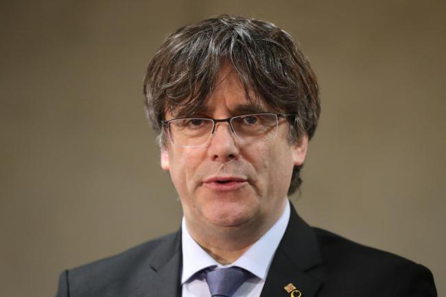 Ex-Catalan leader hands himself in to Belgian authorities after warrant issued