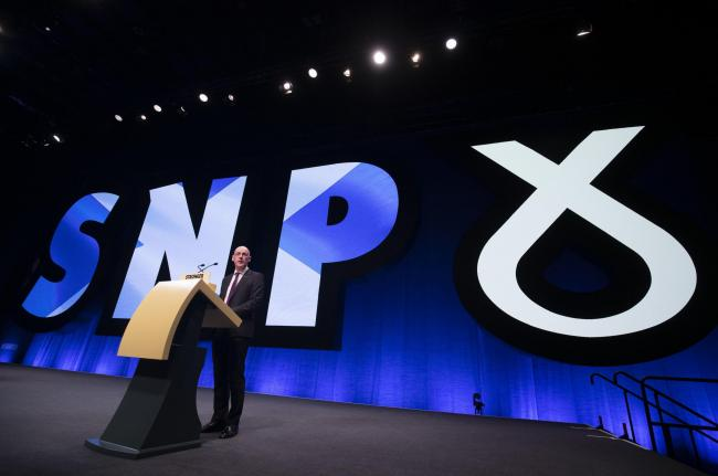 Deputy First Minister John Swinney delivers his address to delegates during the 2019 SNP autumn conference at the Event Complex in Aberdeen. PA Photo. Picture date: Monday October 14, 2019. See PA story POLITICS SNP. Photo credit should read: Jane Barlow