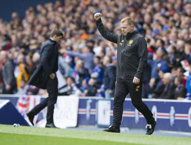Celtic manager Neil Lennon salutes Celtic's winning goal at Ibrox in September as his Rangers counterpart looks away. Picture: Jeff Holmes/PA Wire.