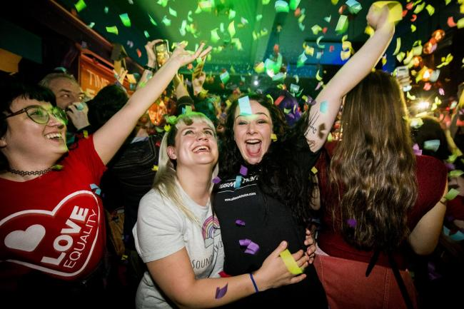 Martha Brown (left, grey t-shirt) with her partner Louise McCullough (right, black t-shirt) and equal marriage supporters at Maverick Bar, Belfast, celebrate the change to abortion and same sex marriage laws in Northern Ireland at 00:01. The law passed by