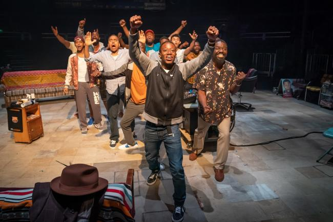 The cast of Bijan Sheibani's production of Barber Shop Chronicles by Inua Ellams. Image by Marc Brenner