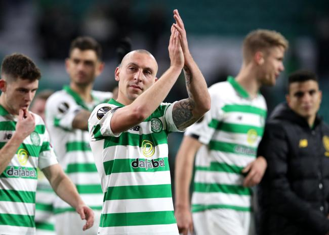 Scott Brown - whose DVD 'Broony: Captain. Leader. Legend' comes out on Friday - applauds Celtic's fans following the UEFA Europa League group E win against Lazio. Picture: Getty Images