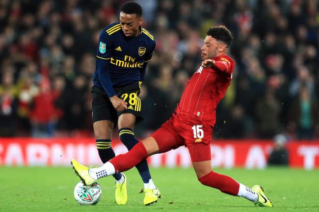 Liverpool's Alex Oxlade-Chamberlain, right, knows his performances have to improve if he is to start regularly (Mike Egerton/PA)