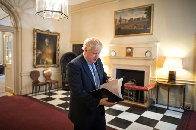 Boris Johnson preparing to leave Downing Street to address the nation at the formal start of the General Election campaign.