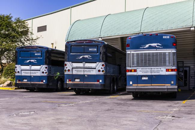 The Aberdeen-based firm's pre-tax loss came after the write-down in the US Greyhound coach business. Buses parked in Indianapolis. Getty Images.