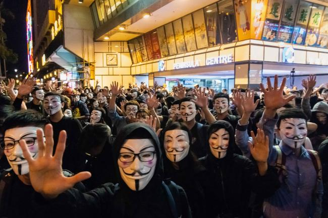 HONG KONG, CHINA - NOVEMBER 05: Protestors in Guy Fawkes mask march on November 05, 2019 in Hong Kong, China. Hong Kong slipped into a technical recession on Thursday after anti-government demonstrations stretched into its fifth month while protesters con