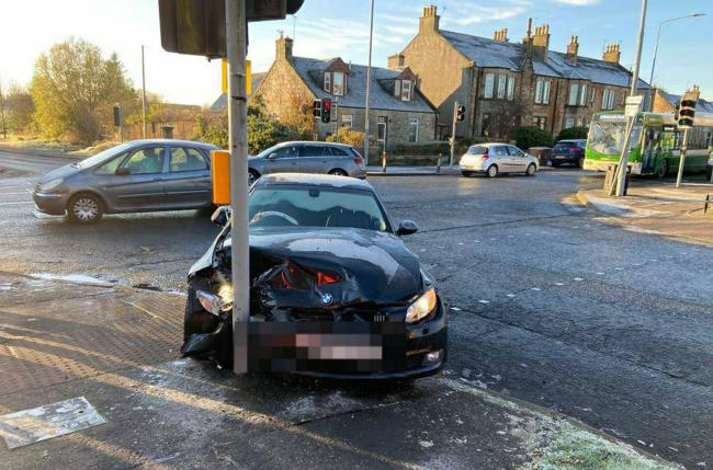 Driver with frosted windscreen charged after crashing into lights