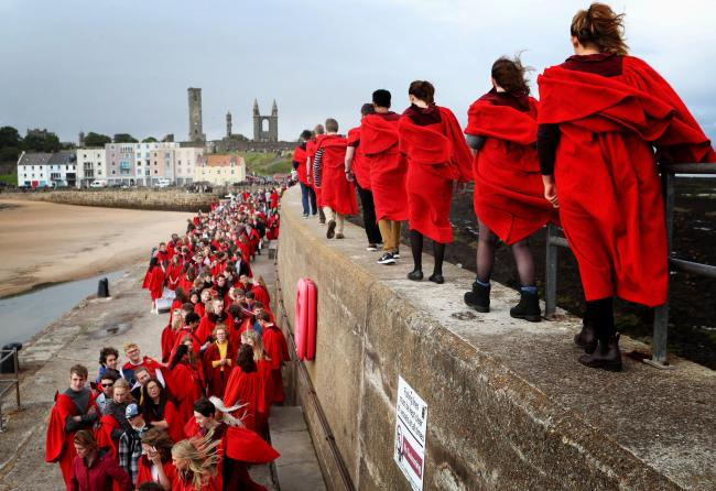 The University of St Andrews has taken action to try to prevent an online business selling a cheaper version of its iconic red gown. Picture: Jane Barlow/PA Wire.