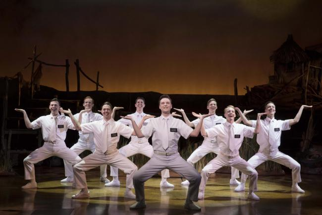 Stephen Ashfield, center, as Elder McKinley, and company in The Book of Mormon 406..The Book of Mormon.New York, N.Y..April 11, 2019.Photo Credit: Julieta Cervantes.