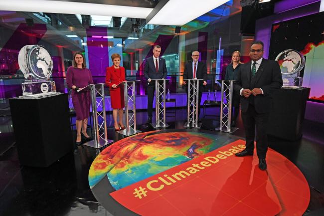 LONDON, ENGLAND - NOVEMBER 28: Krishnan Guru-Murthy (foreground) with (rear left to right) Liberal Democrat leader Jo Swinson, SNP leader Nicola Sturgeon, Plaid Cymru leader Adam Price, Labour Party leader Jeremy Corbyn and Green Party Co-Leader Sian Berr