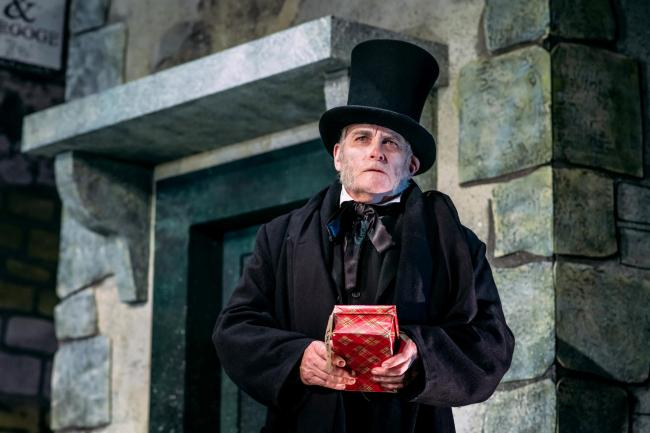 Crawford Logan as Scrooge in An Edinburgh Christmas Carol, adapted and directed by Tony Cownie at the Royal Lyceum Theatre, Edinburgh. Image by Mihaela Bodlovic
