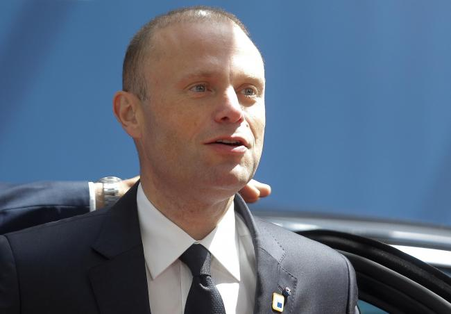 FILE - In this Thursday, June 20, 2019 file photo, Malta's Prime Minister Joseph Muscat arrives for an EU summit at the Europa building in Brussels. Maltese Prime Minister Joseph Muscat said Sunday Dec. 1, 2019, that he would resign in January follow
