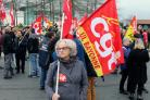 Trade union demonstrators protest in Anglet southwestern France, Saturday Dec. 7, 2019. Strikes disrupted weekend travel around France on Saturday as truckers blocked highways and most trains remained at a standstill because of worker anger at President