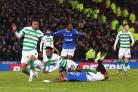 GLASGOW, SCOTLAND - DECEMBER 08: Jeremie Frimpong of Celtic tackles Alfredo Morelos of Rangers FC which leads to a penalty and a red card for Jeremie Frimpong of Celtic during the Betfred Cup Final between Rangers FC and Celtic FC at Hampden Park on Decem