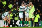Scott Brown congratulates goalkeeper Fraser Forster, right, after Celtic had beaten Rangers in the Betfred Cup final. Photo: Michael Steele/Getty Images.