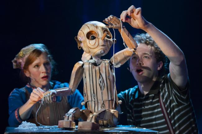 Elisa de Grey and Liam KIng with Rachael Canninbg's puppet in the Citizens Theatre production of Pinocchio at Tramway, Glasgow. Image by Tim Morozzo