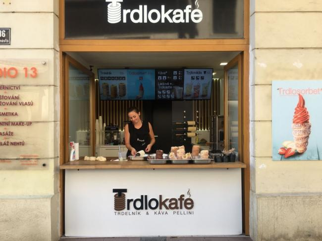 Ian Kinloch spotted this café in the Czech Republic. We don't want to dump on the owners for such a regrettable sign, though perhaps it would have been better if someone had poo-pooed the name before it was firmly decided upon.