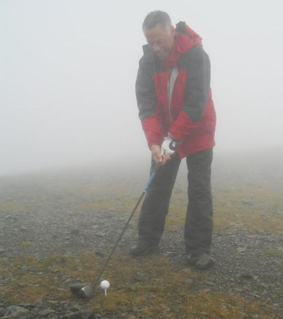 Hill-walking lover John Mulgrew makes one of his more unusual tee-shots