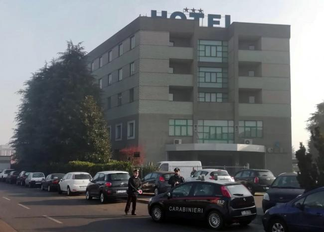 Police surrounded the hotel where Hughes was apprehended, reportedly under a false Latvian identity