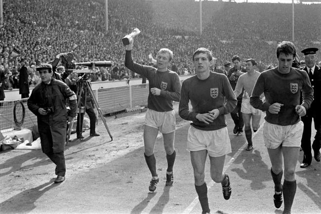 Martin Peters (second left) celebrates England's World Cup triumph in 1966. Picture: PA Photos/PA Wire