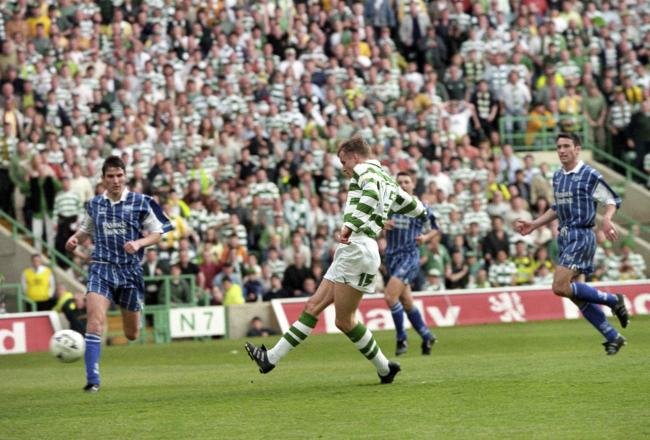 09/05/98 BELL'S PREMIER DIVISION.CELTIC V ST JOHNSTONE (2-0).CELTIC PARK - GLASGOW.Harald Brattbakk slots home Celtic's second goal of the match..
