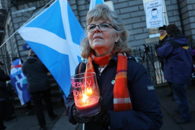 Scottish Independence supporters hold a candlelit vigil outside the Scotland Office.