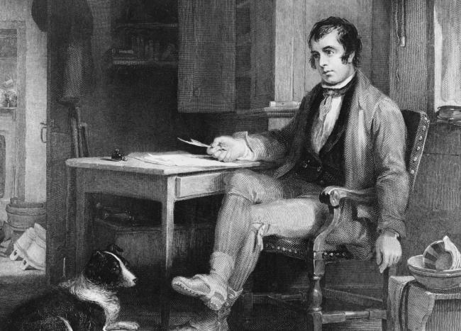 Robert Burns at work. Picture: Hulton Archive/Getty