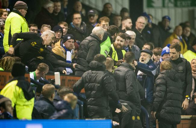 A Kilmarnock fan shouts at Leigh Griffiths, left, at Rugby Park