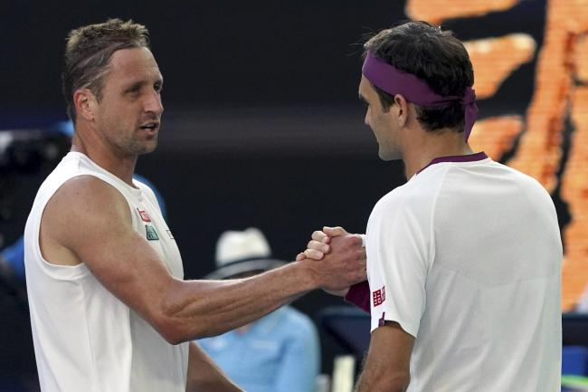 Roger Federer, right, shakes hands with Tennys Sandgren after their remarkable encounter