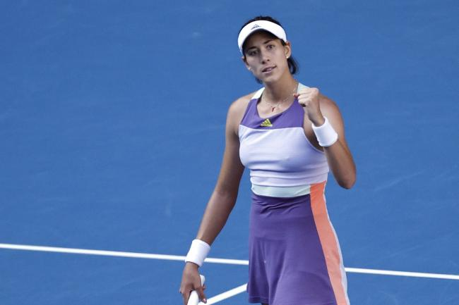 Spain's Garbine Muguruza celebrates victory over Simona Halep