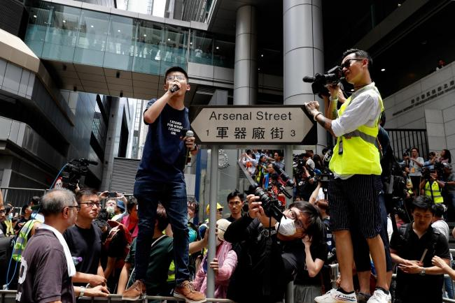 Pro-democracy activist Joshua Wong speaks to students at the police headquarters in Hong Kong in June 2019. Picture: AP
