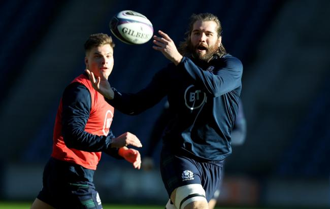 Ben Toolis passes the ball at Scotland training. (Photo by David Rogers/Getty Images).