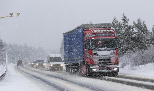 Traffic had to tread carefully on the A9 near Inverness yesterday as blizzards hit the Highlands Pictures: Peter Jolly.