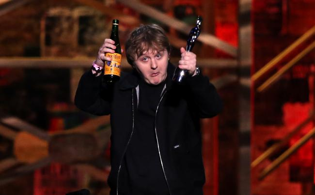 Lewis Capaldi swigs bottle of Buckfast after winning Brits Song of the Year prize