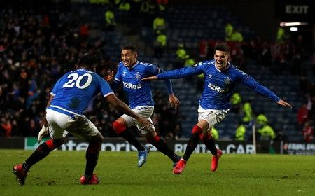 Rangers Ianis Hagi (right) celebrates scoring his side's third goal of the game during the UEFA Europa League round of 32 first leg match at Ibrox Stadium, Glasgow.