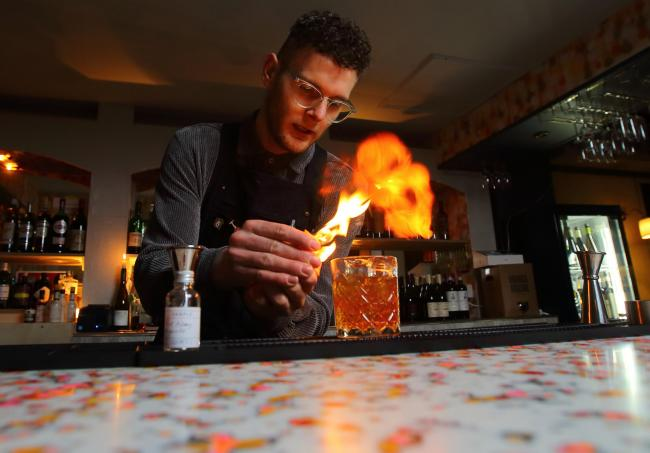 Feature on Bar Vini, Victoria Road in the Southside of Glasgow. Pictured is Jamie Alexander with a whisky cocktail.  Photograph by Colin Mearns13 February 2020