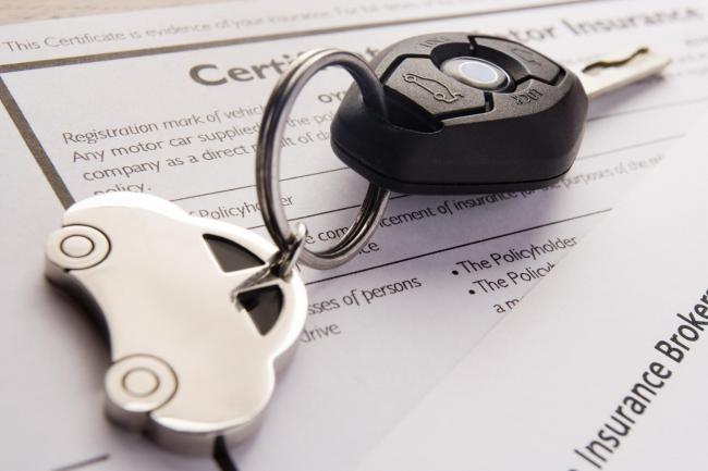 A Generic Photo of car keys on insurance documents. The typical quote for annual comprehensive car insurance has fallen to just under £595, AA Insurance said in July, showing a 9.8% year-on-year drop..