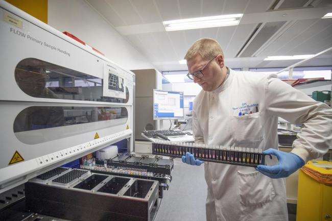 Clinical support technician Douglas Condie extracts viruses from swab samples at Glasgow Royal Infirmary