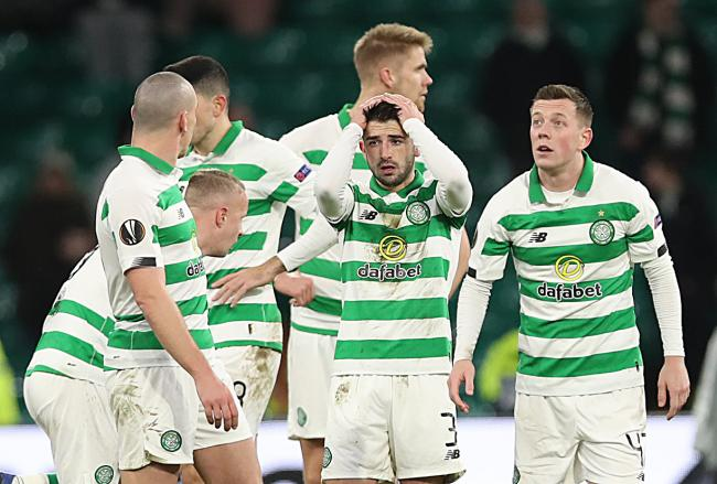 Greg Taylor can't believe it as Celtic crash out of the Europa League.