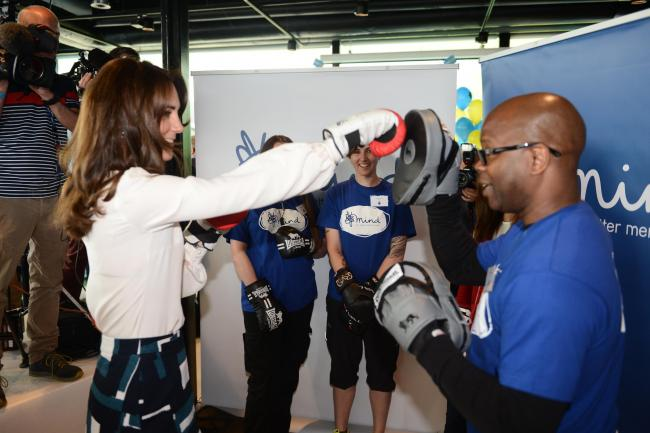 Duke McKenzie boxes with the Duchess of Cambridge during the launch of a mental health campaign