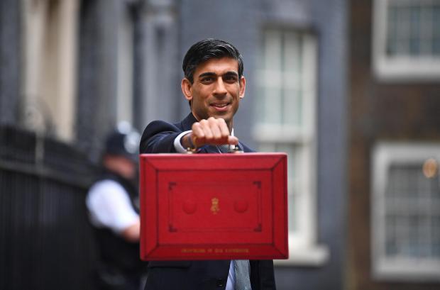 HeraldScotland: Chancellor Rishi Sunak outside 11 Downing Street