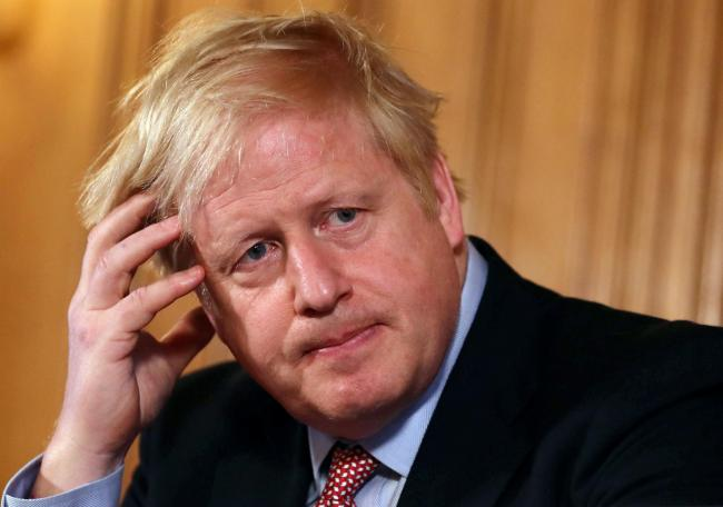 Under pressure: Johnson accused of sending mixed messages on social distancing