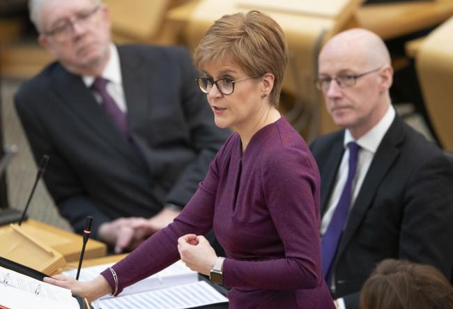 Scotland's First Minister Nicola Sturgeon during First Minster's Questions (FMQ's) in the debating chamber of the Scottish Parliament in Edinburgh. PA Photo. Picture date: Thursday March 19, 2020. See PA story SCOTLAND Questions. Photo credit