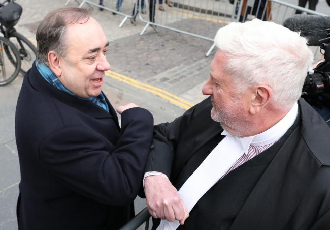 Alex Salmond (left) elbow bumps Gordon Jackson QC as he leaves the High Court in Edinburgh after he was cleared of attempted rape and a series of sexual assault