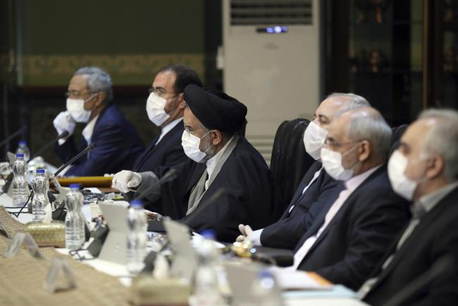Members of Iran's Cabinet wearing face masks at a recent meeting