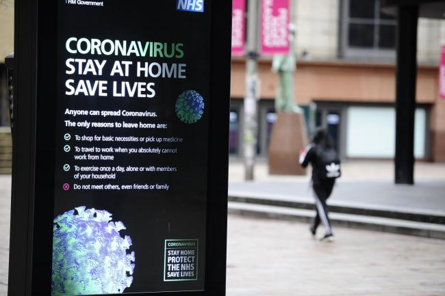 GLASGOW, SCOTLAND - MARCH 25: a coronavirus warning sign is seen on March 25, 2020 in Glasgow, Scotland.  The UK and devolved governments have mandated that everyone apart from key workers stay in their homes for the next three weeks at least so try to sl