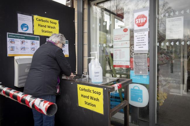 The locals at Ballachulish, Glencoe, have set up a hand wash station outside the village supermarket for customers. Photo: Jane Barlow