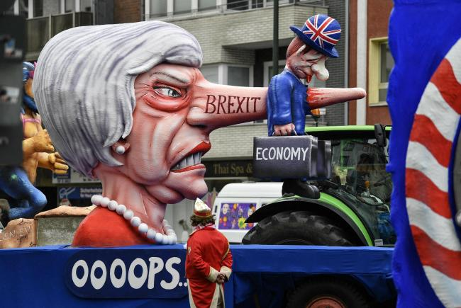 A carnival float depicts fromer British Prime Minister Theresa May and Brexit prior to the traditional carnival parade in Duesseldorf Picture: MARTIN MEISSNER/AP.
